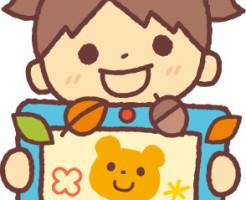 クマの絵を持つ女の子